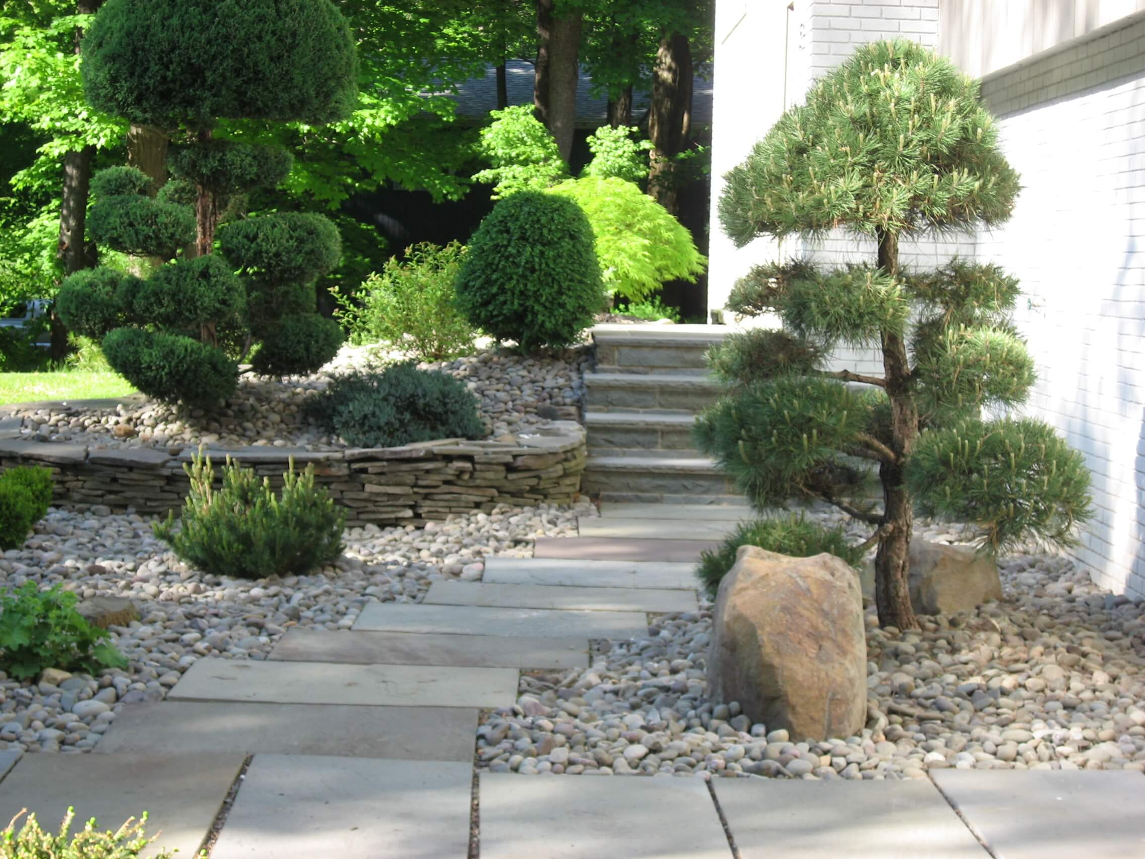 Landscape design landscape garden design in stone for Creative landscape design